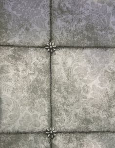 Kings Mirror Wallpaper A distressed antique mirror effect wallpaper in a tile layout with a subtle background floral design in reflective gilver.