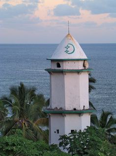 Moya - Mezquita Aljama - Comoros Islands. The Comoro Islands or Comoros form an archipelago of volcanic islands situated off the south-east coast of Africa, to the east of Mozambique and north-west of Madagascar