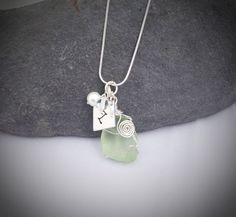 Stunning Seaglass Necklace, beautiful seaglass wrapped and accompanied by a pearl and a monogram.
