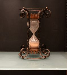 On the mantel. Hourglass Fashion, Hourglass Style, Water Clock, Hourglass Sand Timer, Sand Timers, Shades Of Peach, Antique Clocks, Black Peach, Glass Art