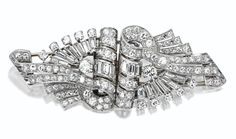 A DIAMOND DOUBLE-CLIP/BROOCH, THE BROOCH CIRCA 1930. the modified lozenge-shaped brooch of scrolling ribbon motif set with 104 round and 145 baguette diamonds weighing a total of approximately 5.25 carats, mounted in platinum,