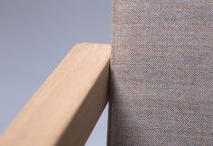 Detail of LEAN, a archetypal wooden chair with Kvadrat fabrics. Design by Gerard de Hoop for Odesi.