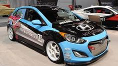 When Bisimoto took on the challenge of tuning the rather pedestrian Hyundai Elantra GT into a proper performance vehicle for SEMA, it took no half-measures. Hyundai Accent, Mustang, Beast From The East, Hyundai Veloster, Japanese Imports, Auto News, Motorcycle Garage, Latest Cars, Car Manufacturers