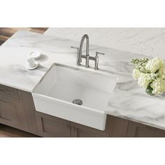 Fireclay sinks have a timeless appeal that has endured for decades. Choose an Elkay fireclay farmhouse apron front kitchen sink, a convenient prep sink or a bar sink. The attractive, smooth glaze is easy to clean. Beauty and durability come together in a Fireclay Farmhouse Sink, Fireclay Sink, Farmhouse Sink Kitchen, Undermount Sink, Kitchen Sinks, Laundry Sinks, Rustic Kitchen, Vintage Kitchen, Laundry Room