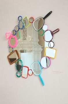 Mirror, mirror, on the wall... This idea is awesome. Get a simple circular wall mirror and create a board out of handheld mirrors. Unique and a little offbeat. Sure to be a hit.