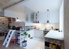 This 387 square foot (36 sqm) apartment was used as a furniture storage room for 30 years, before it was updated with a loft bed and plenty of storage.