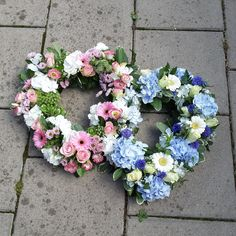 A #DoubleOpenHeart #funeral #tribute. One #heart is in a mixture of #white and #pink #flowers, the other heart is in a mixture of #blue and #whiteflowers. Florist London, Funeral Tributes, Same Day Flower Delivery, White Flowers, Floral Wreath, Seasons, Heart, Blue, Floral Crown