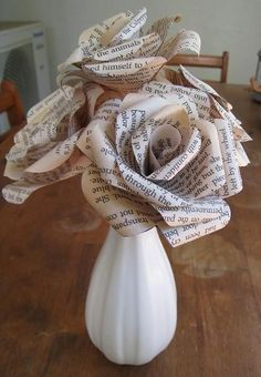 DIY Paper Flower - What a clever way to use up pages from an old damaged book!