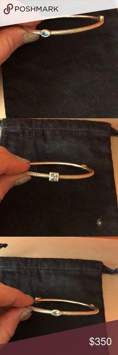 David yurman 3 station bangle. Blue topaz.  Fits 7-7.25 wrist and smaller.  Gold and sterling silver.  Very good condition.  Worn very little. David Yurman Jewelry Bracelets