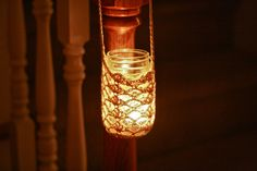 Rustic up your autumn evenings by suspending some candles with this great crocheted mason jar cozy tutorial from What Would Jen Do? Mason Jar Holder, Mason Jar Cozy, Hanging Mason Jars, Mason Jar Candles, Mason Jar Crafts, Scented Candles, Craft Stick Crafts, Yarn Crafts, Craft Ideas