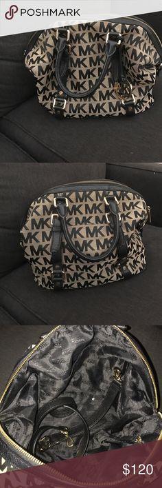 Michael Kors purse Beige and black purse. Comes with shoulder strap. Michael Kors Bags Shoulder Bags