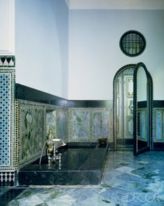 """At the Marrakech retreat of Yves Saint Laurent and Pierre Bergé, designer Bill Willis created a sublime, sophisticated setting using an intricate interplay of green and black marble with turquoise mosaics."""