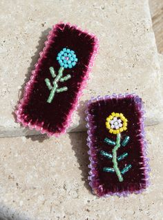 "These lovely brooches were crafted by Mary Pheasant of the Wikwemikong First Nation. Beaded on velvet and backed with deerskin, each features the image of a flower. Choose either yellow or blue. Measures 1.75"" x 1"" (4.5 cm x 2.5 cm)."