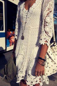 white lace and crochet boho dress Fresh Festival Fashion: Music Festivals, coachella and concerts and of spring and summer are right around the corner, are you ready for the fashion fun?! Boho chic styles and be achy beauty trends are the way to go! When looking for accessories go haute hippie styled with fringe bags, woven shoes, and colored sunglasses. Embellished bags make for an ethnocentric carryall.
