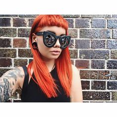 Stylist @perplexed81_ of @bandbhair used #ElectricLava and #PsychedelicSunset on @madisonsewell_ to achieve this amazing and unique shade of burnt orange. Paired with her blunt bangs and shades, this look is too #cool!