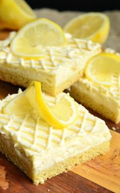 Vanilla Bean Lemon Cheesecake Bars. A layer of vanilla & lemon flavored sugar cookies topped with a layer of smooth vanilla lemon cheesecake and drizzled with white chocolate. | from willcookforsmiles.com