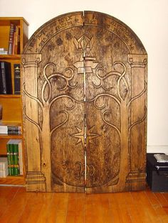 Doors of Durin hand carved book shelf. amazing!