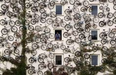 A bicycle shop in Altlandsberg, Germany advertises their goods with a wall of around 120 bikes mounted on the building's exterior in lieu of a sign ! It's hard to mistake what business they're in !