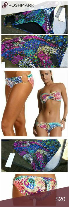 NWT Vitamin A pin up star, hipster bikini bottoms Mini floral print in a rainbow of hues. Low cut across the hips with wider sides, softly shirred for a flattering fit. Moderately full coverage in the back and Vitamin A's signature gold toned side rings contoured to fit and flatter. Fully lined, new with tags, hygienic protection liner still in tact. Vitamin A Swim Bikinis