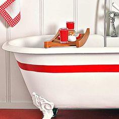 A simple red racing stripe gives this clawfoot tub vavoom!. Via thesnug.com