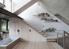 Townhouse B14 by XTH-berlin has slanted walls and doors, nets and slides, and a whole lot of sightlines
