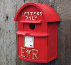 "English Postbox Birdhouse:   Just like English red postboxes, this birdhouse carries the Royal Cipher of Queen Elizabeth II.  9 1/2"" high x 5 1/2"" wide x 3 1/2"" deep"