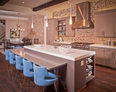 bartop at table height to use dining chairs  exposed bricks wall kitchen