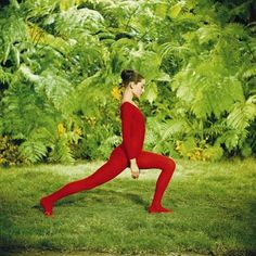 // Audrey Hepburn doing yoga in a thicket.