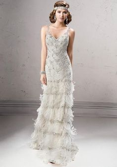 In classic 20's syle, this is what a stunning flapper girl dreams of being married in.