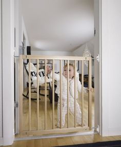 The BabyDan No Trip Wooden Stair Gate 72cm - 78.5cm is a stylish wall mounted stair gate with quick release fittings so that adults can detach the gate when ful