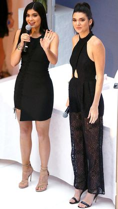 Kylie Jenner in a black mini dress and Kendall Jenner in a black cutout jumpsuit