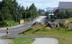 Álfhóll in Kópavogur. Since the elves are believed to live here, the road narrows.