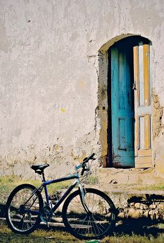Suchitoto - Antique Door and a bike - photo by @KD Eustaquio O'Rourke Slawson Tramper Copeland