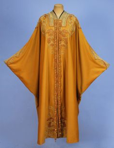 Edwardian Art Nouveau Opera Cocoon With Seahorses - Mustard Wool Felt With Gold Lame Applique At Neckline, Trimmed With Gold Soutache, Terra Cotta Cord And Brown Embroidery In A Pattern Of Seahorses And Stylized Seaweed, Fancy Tasseled Braided Rope Ties, Lined In Peach Silk Satin With Embroidered Metallic Net Ribbon Applied To Front Edge  -  Whitaker Auctions