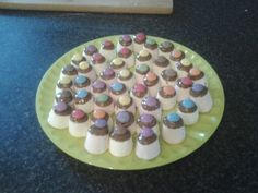 Kids party food- Marshmallows dipped in melted chocolate topped off with a smartie