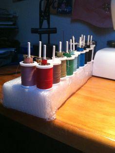 Cheap thread and bobbin organizer made with Styrofoam & Popsicle sticks #diy #threadorganizer #sewing
