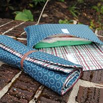 Sushi-Roll Changing Pad and Diaper Pouch Tutorial on Sew Mama Sew at http://www.sewmamasew.com/2010/10/october-15-sushi-roll-changing-pad-and-diaper-wipes-pouch-tutorial-sew-baby-giveaway/