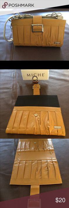 Miche Classic Shell Classic size magnetic shell in mustard yellow.   Flap secures the shell is closed with a snap. Silver buckle ads a classy detail. Classic Bags Satchels
