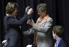 "This almost made me cry. Happy for Holly but missing Pat already. Former Tennessee women's college basketball coach Pat Summitt, left, give her whistle to new head coach Holly Warlick, center, as her son, Tyler Summitt, right watches during a news conference Thursday, April 19, 2012, in Knoxville, Tenn. Summitt said it's been a ""great ride"" and it is the right time for her to step down after coaching the Tennessee Lady Vols for nearly four decades. (AP Photo/Wade Payne)"