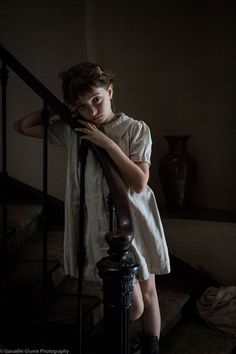 Elise stood at the bottom of the stairs watching her father as he argued with a dark figure.