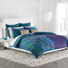 The watercolor design on the Amy Sia Midnight Storm Comforter Set b...