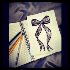 My pretty little lace bow drawing...next tattoo I think