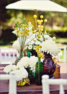 Jewel tones.  and arrangement like this would look great on the cabinent