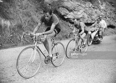 Cyclist Fausto Coppi leads Jean Robic in the tenth stage (between Lausanne, Switzerland and l' Alpe-d'Huez) of the 1952 Tour de France. | Location: Between Lausanne, Switzerland and l' Alpe-d'Huez, France.
