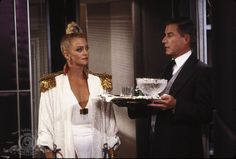 Goldie Hawn as Joanna Stayton in Overboard (1987). Gold shoulder pads and that top knot tho.