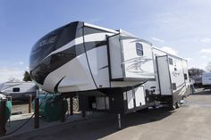 """DURABILITY MEETS THE PEAK OF ELEGANCE!!!   2017 Heartland Torque TQ321  Retreat to your master suite after an active day of riding and sprawl out on your king-size high-end pillow top mattress for a supreme night's sleep! Nightshades ensure total darkness. Entertainment is provided with a 40"""" flat screen TV. The TQ321 is 38' 10"""" long with a dry weight of 11570 lbs.  Give our Torque expert John Sobczak a call 231-903-6220 for pricing and more information."""