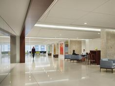 The entry to the third floor, the facility's largest, evokes a public concourse that provides ease of navigation. A variety of seating areas supports the diverse needs of patients and families. Photo: Perkins+Will, Copyright 2013 Halkin Mason Photography.