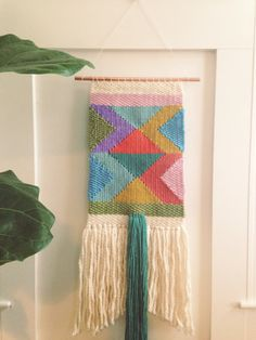 Woven wall hanging handmade by me using a lap loom. This is a very detailed and colorful wall hanging! Colors include, teal, mustard yellow, green,