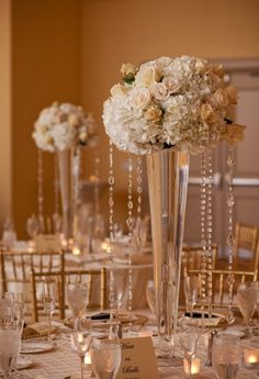 Centerpieces with crystal beading.. maybe fake pearls... purple flowers.. and candles.