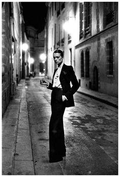 Helmut Newton - Rue Aubriot, Paris.   Suit: Yves Saint Laurent. Vogue Paris, 1975.